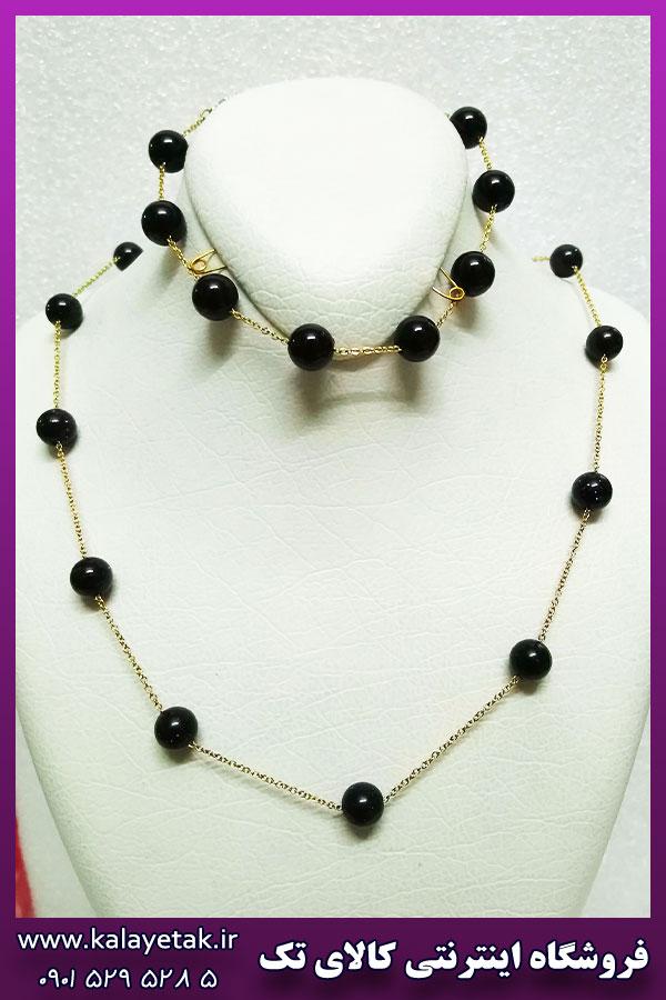 ست زنجیر و دستبند مهره مشکی زنانه طلایی استیل