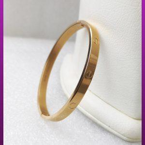 دستبند کارتیه پیچ طلایی استیل